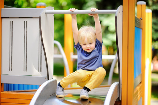 a child about to slide down a slide